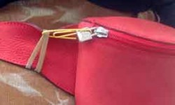 Pickpockets in frustration. Secure your fanny pack zipper with a paperclip and rubber band.